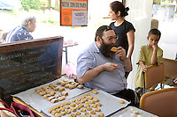 Mayer Levy (3R) tucks in to a pastry during an Oriental pastry workshop held by the non-profit association Batisseusses de Paix (or Women Peace Builders) that seeks to build ties between Muslim and Jewish women, in a restaurant in Creteil, outside Paris, France, 24 June 2008.