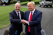 United States President Donald J. Trump and the President of FIFA Gianni Infantino speak to the press as United States President Donald J. Trump departs the White House in Washington D.C., U.S. for a rally in North Carolina on September 9, 2019.  <br /> <br /> Credit: Stefani Reynolds / CNP