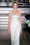 Model walks runway in a Yaneida bridal gown from the Atelier Pronovias 2014 collection by Pronovias, at St. James' Church in New York City, on November 12, 2013.