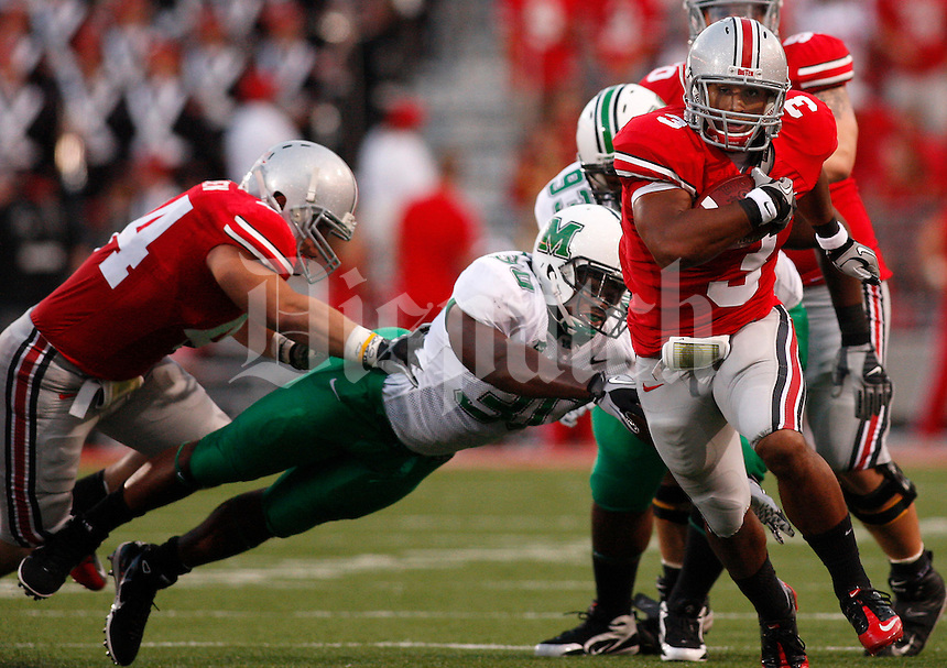 Ohio State running back Brandon Saine (3) eludes Marshall linebacker Mario Harvey (30) during the first quarter of the NCAA football game at Ohio Stadium on Thursday, September 2, 2010. (Photo by Jonathan Quilter)