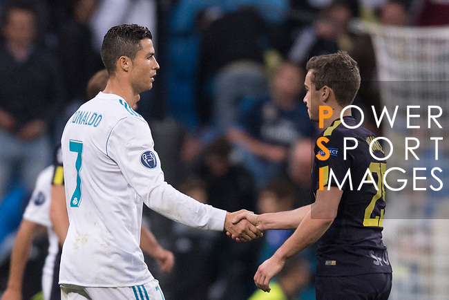 Cristiano Ronaldo of Real Madrid (L) shakes hand with Christian Eriksen of Tottenham Hotspur FC (R) after the UEFA Champions League 2017-18 match between Real Madrid and Tottenham Hotspur FC at Estadio Santiago Bernabeu on 17 October 2017 in Madrid, Spain. Photo by Diego Gonzalez / Power Sport Images
