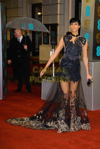 Zawe Ashton.EE British Academy Film Awards at The Royal Opera House, London, England 10th February 2013.BAFTA BAFTAS arrivals full length black lace detail beads beaded pattern sheer clutch bag hands arms .CAP/CJ.©Chris Joseph/Capital Pictures