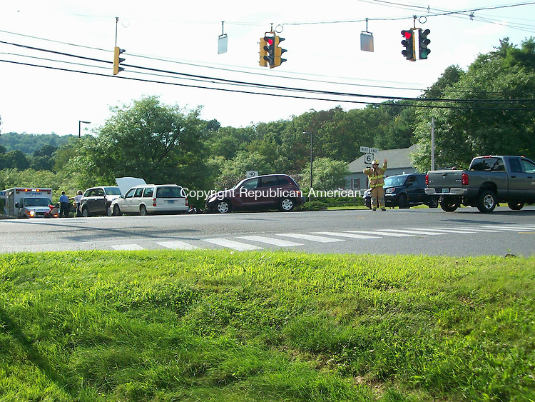 WOODBURY, CT - 25 August 2009 - 082509QL02 - State police and firefighters investigate a four-car accident at the intersections of Routes 6 and 64 in Woodbury at about 4:30 p.m. Tuesday. No further information was available later Tuesday. Quannah Leonard Republican-American