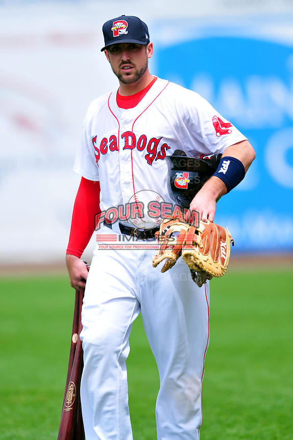 Portland Sea Dogs  first baseman Travis Shaw #21 prior to a game versus the Trenton Thunder at Hadlock Field in Portland, Maine on May 17, 2014. (Ken Babbitt/Four Seam Images)