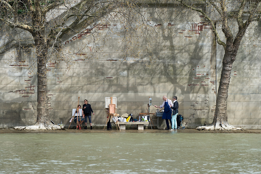 Artists painting on Quai Béthune, Ile St Louis, Paris, with the River Seine high, almost on the Quay. Sunday 8th April 2018. Photograph by Andrew Lyndon-Skeggs of ANLS Photography; www.anlsphotography.photoshelter.com
