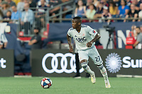 FOXBOROUGH, MA - AUGUST 3: Luis Caicedo #27 of New England Revolution brings the ball forward during a game between Los Angeles FC and New England Revolution at Gillette Stadium on August 3, 2019 in Foxborough, Massachusetts.