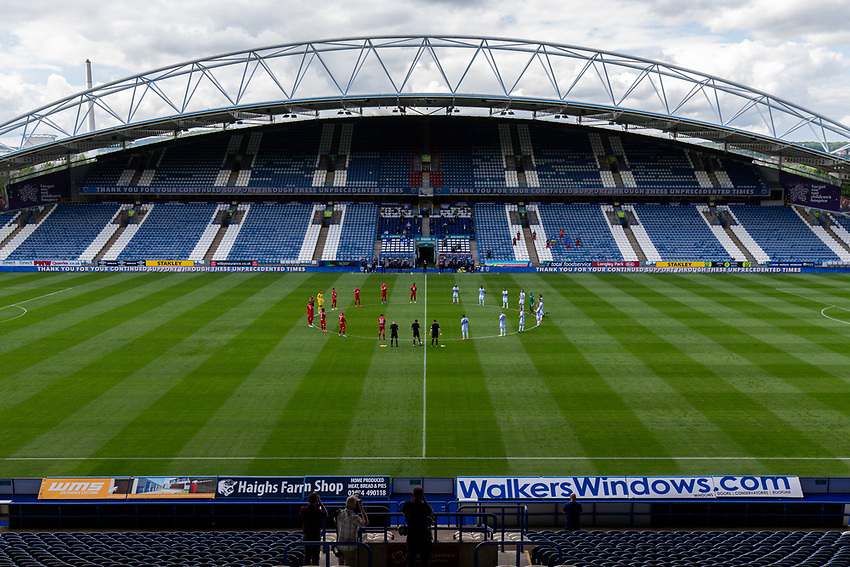 The players and officials applaud the victims of the corona virus<br /> <br /> Photographer Alex Dodd/CameraSport<br /> <br /> The EFL Sky Bet Championship - Huddersfield Town v Wigan Athletic - Saturday 20th June 2020 - John Smith's Stadium - Huddersfield <br /> <br /> World Copyright © 2020 CameraSport. All rights reserved. 43 Linden Ave. Countesthorpe. Leicester. England. LE8 5PG - Tel: +44 (0) 116 277 4147 - admin@camerasport.com - www.camerasport.com
