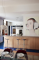 View of the kitchen/dining area to a painting of a young boy by Katinka Lampe