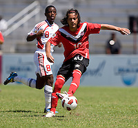 Kevin Aleman (10) of Canada sprints forward past Karl Muckette (8) of Trinidad & Tobago during the quarterfinals of the CONCACAF Men's Under 17 Championship at Catherine Hall Stadium in Montego Bay, Jamaica. Canada defeated Trinidad & Tobago, 2-0.