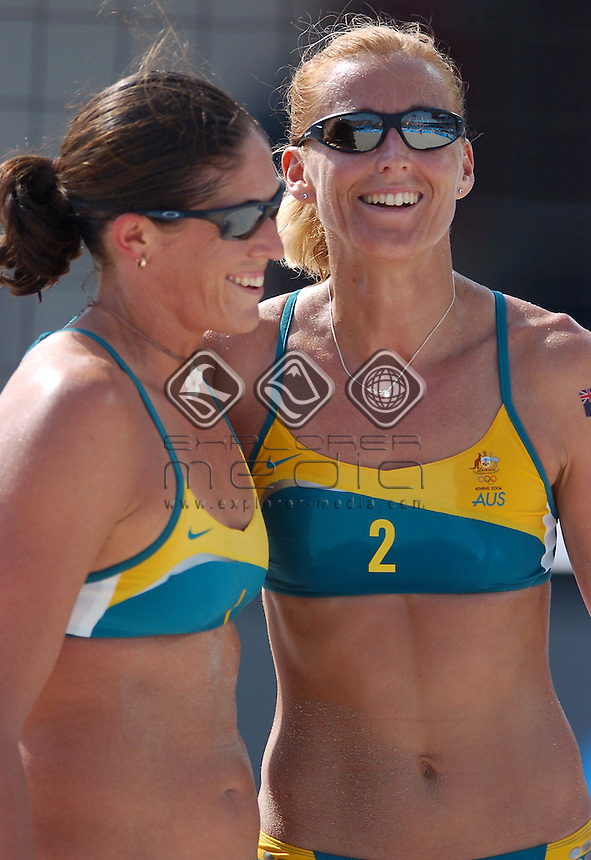 Summer Lochowicz and Kerri Pottharst <br /> Beach Volleyball - AUS Summer Lochowicz and Kerri Pottharst vs. AUS Natalie Cook and Nicole Sanderson.<br /> Summer Olympics - Athens, Greece 2004<br /> Day 7 ,20th August 2004.<br /> &copy; Sport the library/Courtney Harris