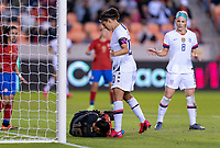 HOUSTON, TX - FEBRUARY 03: Priscilla Tapia #12 of Costa Rica makes a save in front of Carli Lloyd #10 of the United States dribbles during a game between Costa Rica and USWNT at BBVA Stadium on February 03, 2020 in Houston, Texas.