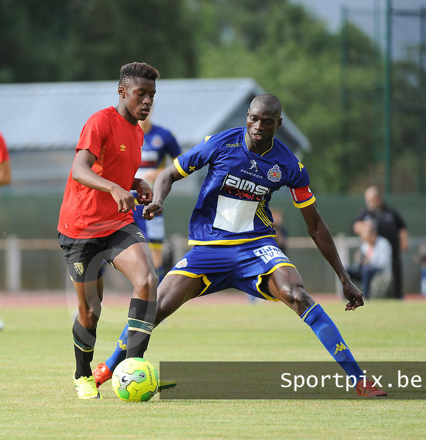 20160713 - DOUAI , FRANCE : RC Lens' Jean Ricner Bellegarde (L) and Waasland Beveren's Ibrahima Seck (R) pictured during a friendly game between Racing Club de LENS and Waasland Beveren during the preparations for the 2016-2017 season , Wednesday 13 July 2016 ,  PHOTO Dirk Vuylsteke | Sportpix.Be