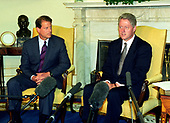 "United States President Bill Clinton, right, and US Vice President Al Gore, left, meet with reporters in the Oval Office of the White House in Washington, DC to discuss the situation in Iraq following the two strikes by US cruise missiles against Iraqi military targets on September 4, 1996.  The President announced the attacks were successful and said that Iraqi leader Saddam Hussein ""knows there is a price to be paid for stepping over the line.""<br /> Credit: Ron Sachs / CNP"