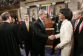 United States President George W. Bush, center, shakes hands with US Secretary of State Condoleezza Rice, right, as he walks out with US Senate Majority Leader Bill Frist (Republican of Tennessee), left, after delivering the State of the Union address to a joint session of Congress, Wednesday, January 31, 2006 in WashingtonDC . Also looking on is US Secretary Of Defense Donald Rumsfeld, far right. <br /> Credit: Pablo Martinez Monsivais / Pool via CNP