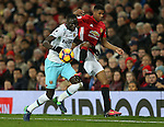 Cheikhou Kouyate of West Ham United tussles with Marcus Rashford of Manchester United during the Premier League match at the Old Trafford Stadium, Manchester. Picture date: November 27th, 2016. Pic Simon Bellis/Sportimage