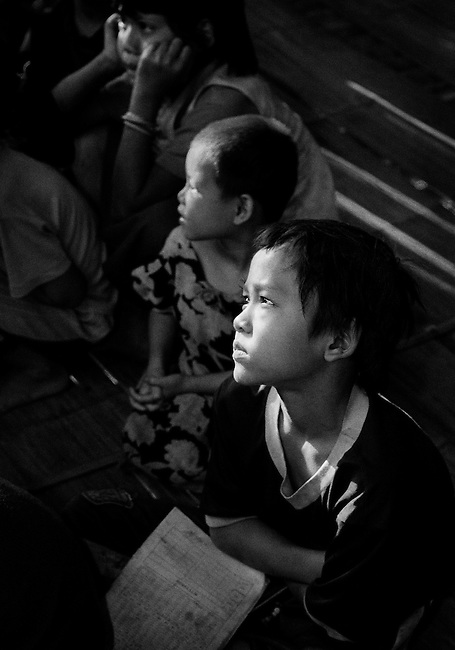 Children in school in the Mae La camp refugee camp, Thailand.  <br /> <br /> The Karen take their education very seriously and consider it a 'wise weapon' against the oppression of Burma's military leaders.  <br /> <br /> It has been reported that the SPDC had strictly forbidden the teaching of any of the ethnic minority languages; as a result, many children grow up illiterate in their mother tongue.<br /> <br /> Thai/Burma border 2004.<br /> <br /> (Please see Galleries for further information).