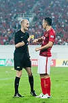 Guangzhou Defender Feng Xiaoting (R) gets a yellow card from Fifa Referee Adham Mohammad Makhadmeh (L) during the AFC Champions League 2017 Round of 16 match between Guangzhou Evergrande FC (CHN) vs Kashima Antlers (JPN) at the Tianhe Stadium on 23 May 2017 in Guangzhou, China. (Photo by Power Sport Images/Getty Images)