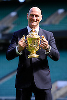 Former World Cup winner Lawrence Dallaglio with the Webb Ellis Trophy during the Rugby World Cup 2015 Venues and Match Schedule Launch at Twickenham Stadium on Thursday 2nd May 2013 (Photo by Rob Munro)
