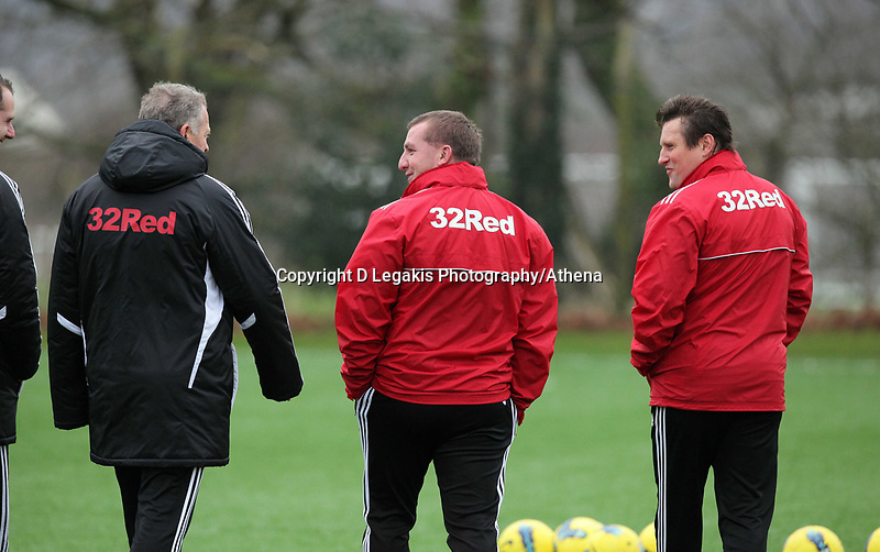 FAO SPORTS PICTURE DESK<br /> Pictured: Manager Brendan Rodgers (C) with coaches Alan Curtis (L) and Colin Pascoe (R). Thursday 12 January 2012<br /> Re: Premier League football side Swansea City FC training session at Llandarcy, south Wales.