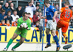 St Johnstone v Dundee Utd....21.04.12   SPL.Alan Mannus collects a back pass header from Frazer Wright.Picture by Graeme Hart..Copyright Perthshire Picture Agency.Tel: 01738 623350  Mobile: 07990 594431