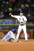 Chicago White Sox second baseman Gordon Beckham (15) turns a double play as Colby Rasmus (28) slides in during a game against the Toronto Blue Jays on August 15, 2014 at U.S. Cellular Field in Chicago, Illinois.  Chicago defeated Toronto 11-5.  (Mike Janes/Four Seam Images)