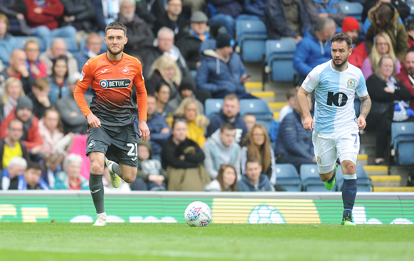 Swansea City's Matt Grimes under pressure from Blackburn Rovers' Adam Armstrong<br /> <br /> Photographer Kevin Barnes/CameraSport<br /> <br /> The EFL Sky Bet Championship - Blackburn Rovers v Swansea City - Sunday 5th May 2019 - Ewood Park - Blackburn<br /> <br /> World Copyright © 2019 CameraSport. All rights reserved. 43 Linden Ave. Countesthorpe. Leicester. England. LE8 5PG - Tel: +44 (0) 116 277 4147 - admin@camerasport.com - www.camerasport.com
