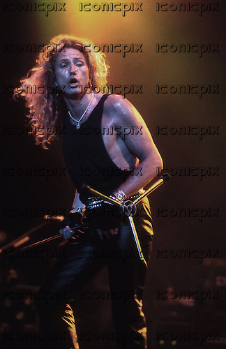 Whitesnake - vocalist David Coverdale performing live on the Greatest Hits Tour of the UK at the Civic Hall Wolverhampton UK - 19 Jul 1994.  Photo credit: George Chin/IconicPix