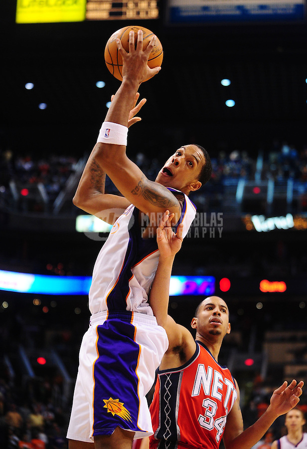 Jan. 12, 2011; Phoenix, AZ, USA; Phoenix Suns center (8) Channing Frye against the New Jersey Nets at the US Airways Center. The Suns defeated the Nets 118-109 in overtime. Mandatory Credit: Mark J. Rebilas-