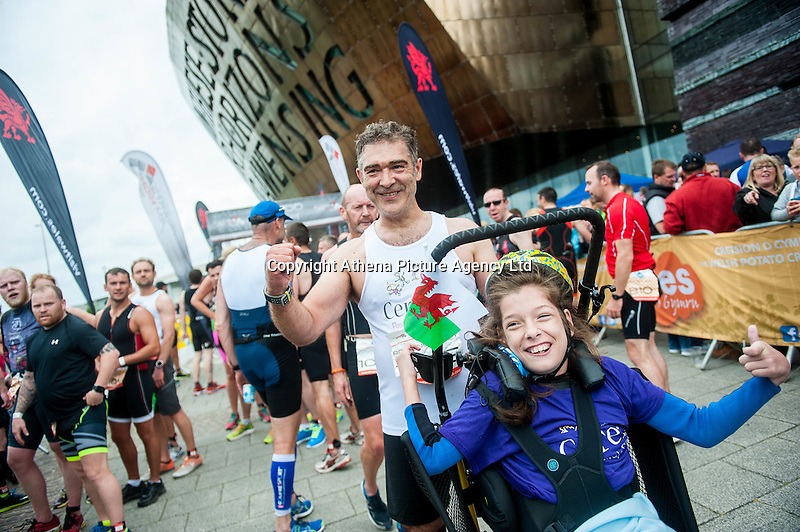 COPY BY TOM BEDFORD<br /> Sunday 26 June 2016<br /> Pictured: Poppy and dad Rob cross the finish line <br /> Re: A very special father-and-daughter team have tackled the Cardiff Triathlon.<br /> Poppy Jones, 11, who will be competing alongside dad Rob Jones, wants to win the event.<br /> And she's not going to let the fact that she has quadriplegic cerebral palsy , which means she can't sit, stand, roll or support herself, and chronic lung disease stop her.<br /> She will be by Rob's side every step of the way thanks to a cutting-edge wheelchair and boat – for Rob to push or pull – designed especially for the event, which sees participants take part in a swim across Cardiff Bay , a run and a bike ride.