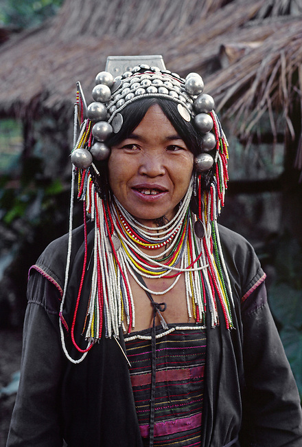 AKHA TRIBAL WOMAN wearing the traditional SILVER HEAD DRESS - NORTHERN, THAILAND.