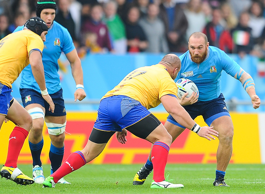 Italy's Davide Giazzon is tackled by Romania's Andrei Ursache<br /> <br /> Photographer Craig Thomas/CameraSport<br /> <br /> Rugby Union - 2015 Rugby World Cup Pool D - Italy v Romania - Sunday 11th October 2015 - Sandy Park, Exeter <br /> <br /> &copy; CameraSport - 43 Linden Ave. Countesthorpe. Leicester. England. LE8 5PG - Tel: +44 (0) 116 277 4147 - admin@camerasport.com - www.camerasport.com