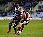 Ben Osborn of Sheffield Utd challenged by Pele of Reading during the FA Cup match at the Madejski Stadium, Reading. Picture date: 3rd March 2020. Picture credit should read: Simon Bellis/Sportimage