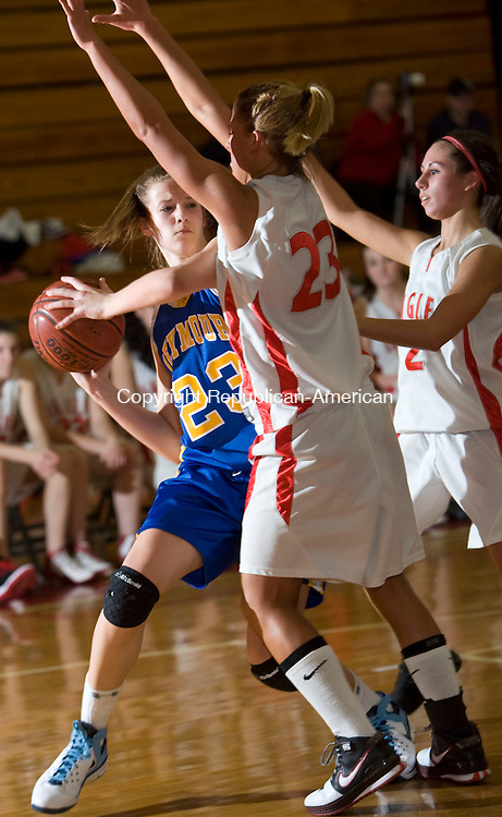 WOLCOTT, CT - 12 FEBRUARY 2009 -021209JT13-<br /> Seymour's Christina Cretella looks for a pass around Wolcott's Carly Murphy during Thursday's game at Wolcott. At right is Wolcott's Emily Muckle. Wolcott won, 57-30.<br /> Josalee Thrift / Republican-American