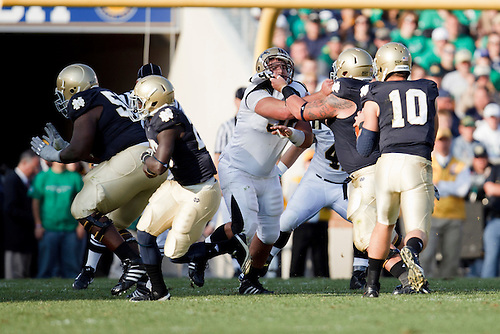 Notre Dame center Braxston Cave (#52) locks up with Western Michigan defensive tackle Drew Nowak (#92) during NCAA football game between Western Michigan and Notre Dame.  The Notre Dame Fighting Irish defeated the Western Michigan Broncos 44-20 in game at Notre Dame Stadium in South Bend, Indiana.
