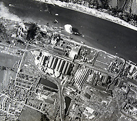 BNPS.co.uk (01202 558833)<br /> Pic:  Tooveys/BNPS<br /> <br /> Taken on 18/09/41 - An attack on the power station and chemical works at Le Grand-Quevilly in occupied France.<br /> <br /> Dramatic photos showing a series of heart-pounding World War Two bombing raids from the pilot's perspective have come to light.<br /> <br /> They were taken from Blenheim bombers undertaking attacks on targets in Germany and Nazi-occupied Netherlands in 1941.<br /> <br /> Several capture the immediate aftermath of a direct hit, with flames and clouds of smoke signifying they had achieved their aim.<br /> <br /> The album, which contains almost 100 photos, has emerged for sale with Toovey's Auctions, of Washington, west Sussex.