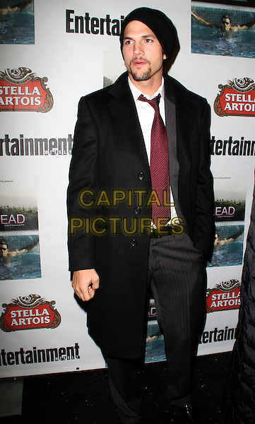 "ASHTON KUTCHER .""Spread"" After Party held at The Village Lift, Park City, Utah, USA..January 17th, 2009.full length black hat goatee facial hair coat red tie jacket grey gray trousers .CAP/ADM/KB.©Kevan Brooks/AdMedia/Capital Pictures."