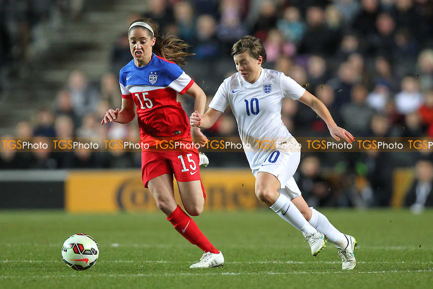 Francesca Kirby of England seeks to evade Morgan BRIAN of USA - England Women vs USA Women - International Football Friendly Match at Stadium MK, Milton Keynes Dons FC - 13/02/15 - MANDATORY CREDIT: Gavin Ellis/TGSPHOTO - Self billing applies where appropriate - contact@tgsphoto.co.uk - NO UNPAID USE