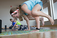 "NWA Democrat-Gazette/CHARLIE KAIJO Brimley Wooldridge, 11, of Bella Vista performs a yoga movement during a kids yoga class, Monday, July 8, 2019 at Yoga Story in Bentonville. <br /> <br /> ""It helps them to learn to breath, pay attention to their bodies, work through emotions and sensations,"" said instructor Kari Pace describing the benefits of yoga for kids. ""I was a very anxious kid so it would have been nice to have a technique like this. It's fun to share it with my kids and other kids."""