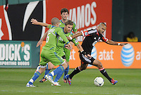 D.C. United forward Maicon Santos (29) shields the ball against Seattle Sounder midfielder Brad Evans (3) and midfielder Osvaldo Alonso (6) D.C. United tied the Seattle Sounders, 0-0 at RFK Stadium, Saturday April 7, 2012.