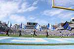 "30 November 2013: Duke cheerleaders run flags across the endzone spelling ""Duke"" after a touchdown. The University of North Carolina Tar Heels played the Duke University Blue Devils at Keenan Memorial Stadium in Chapel Hill, NC in a 2013 NCAA Division I Football game. Duke won the game 27-25."