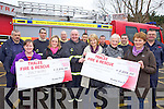 DONATIONS: Members of the Tralee Fire Brigade present the proceeds of pre-Christmas fundraisers to the Alzheimer's Society and the Emly Ward of Kerry General Hospital on Wednesday, front l-r: Marie O'Brien, Maudie Creagh, John O'Donnell, Katie Rael, Margaret Byrne, Kay McNamara. Back l-r: John Fitzgerald, John O'Donnell, Gareth Elbell, Mark Rael, Mike Collins, Nathan Tadier, Nigel Corner.
