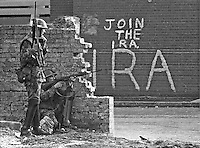 Soldiers with rifles in Bogside area of Londonderry, N Ireland, UK. Join the IRA sign in background. September 1969. 196909000366<br />