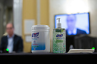Purell cleaning products sit on a table as Mark Mulligan, MD, of New York University's Grossman School of Medicine, speaks via video call during a United States Senate Aging Committee hearing at the United States Capitol in Washington D.C., U.S. on Thursday, May 21, 2020.  Credit: Stefani Reynolds / CNP /MediaPunch