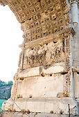 Detail of the Golden Menorah in the Arch of Titus, located on the Via Sacra, just to the south-east of the Roman Forum in Rome, Italy, which was built to commemorate Titus's victory in Judea, depicts a Roman victory procession with soldiers carrying spoils from the Temple, including the Menorah, which were used to fund the construction of the Colosseum, on Wednesday, October 23, 2013.  It was constructed c. 82 AD by the Roman Emperor Domitian shortly after the death of his older brother Titus to commemorate Titus' victories, including the Siege of Jerusalem in 70 AD. The Arch is said to have provided the general model for many of the triumphal arches erected since the 16th century—perhaps most famously it is the inspiration for the 1806 Arc de Triomphe in Paris, France, completed in 1836.  This, the south panel, depicts the spoils of war looted from the Temple in Jerusalem after its destruction by the Romans. The Golden Menorah is the main focus and is carved in deep relief. Other sacred objects being carried in the triumphal procession are the Gold Trumpets and the Table of Shew bread. These spoils were likely originally colored gold, with the background in blue. In 2012 the Arch of Titus Digital Restoration Project discovered remains of yellow ochre paint on the menorah relief.  <br /> Credit: Ron Sachs / CNP