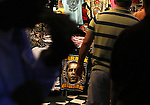 People walk past a store selling T shirts of Presidential candidate Barack Obama in New Orleans Louisiana Friday Oct 24 2008. Americans will go to the polls on Nov 4, at a time of great Financial crisis, war in Iraq and Afghanistan, to elect a  new President. A vote, that will affect not only America, but the whole world. Photo by Eyal Warshavsky .