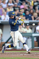 Michigan Wolverines catcher Joe Donovan (0) swings the bat against the Vanderbilt Commodores during Game 3 of the NCAA College World Series Finals on June 26, 2019 at TD Ameritrade Park in Omaha, Nebraska. Vanderbilt defeated Michigan 8-2 to win the National Championship. (Andrew Woolley/Four Seam Images)