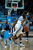 Tar Heel Cetera DeGraffenreid dribbles up the court. (Photo by Rob Rowe)