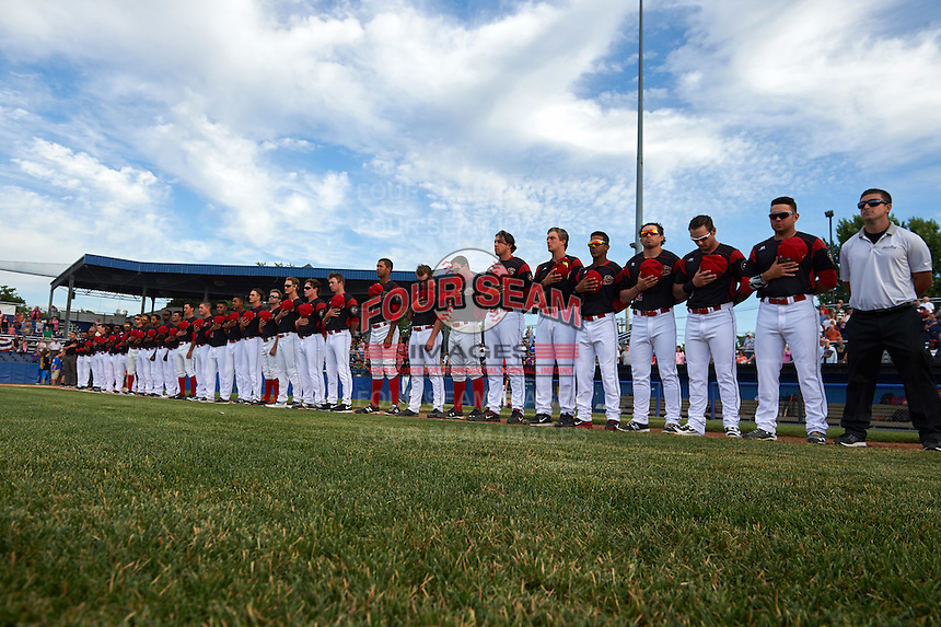 Batavia Muckdogs players stand along the foul line for the national anthem before a game against the State College Spikes on June 22, 2016 at Dwyer Stadium in Batavia, New York.  State College defeated Batavia 11-1.  (Mike Janes/Four Seam Images)