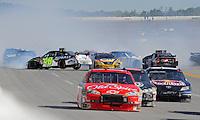 Apr 26, 2009; Talladega, AL, USA; NASCAR Sprint Cup Series driver Jimmie Johnson (48), Juan Pablo Montoya (42) and Bobby Labonte (96) crash during the Aarons 499 at Talladega Superspeedway. Mandatory Credit: Mark J. Rebilas-