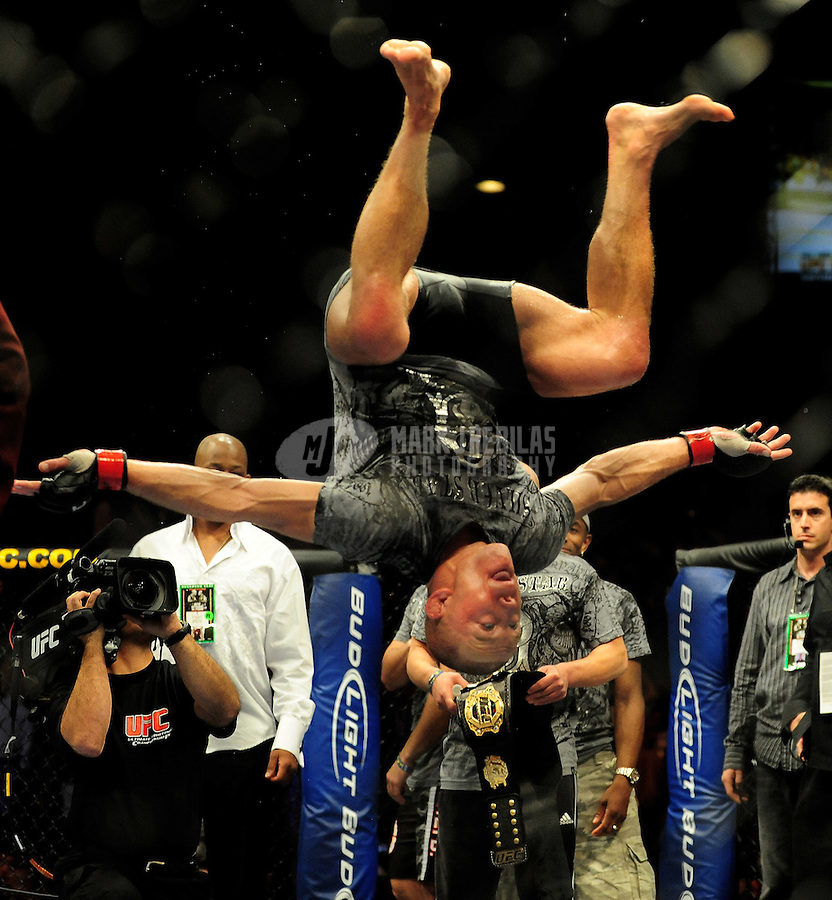 Jan. 31, 2009; Las Vegas, NV, USA; UFC fighter Georges St-Pierre celebrates with a backflip after defeating B.J. Penn (not pictured) during the welterweight championship in UFC 94 at the MGM Grand Hotel and Casino. St-Pierre defeated Penn with a fourth round TKO. Mandatory Credit: Mark J. Rebilas-